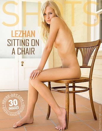 Lezhan sitting on a chair
