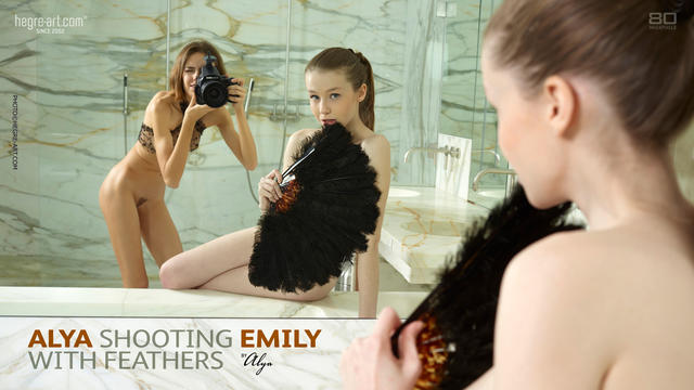 Alya shooting Emily with feathers