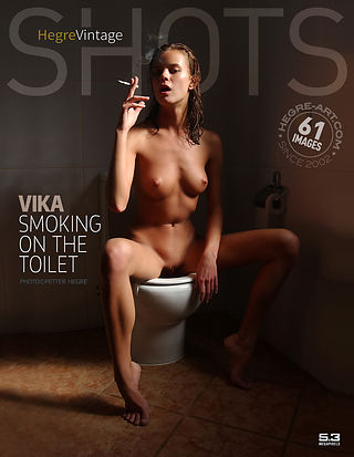 Vika smoking on the toilet