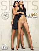 Gloria and Nicole touching