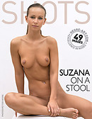 Suzana on a stool
