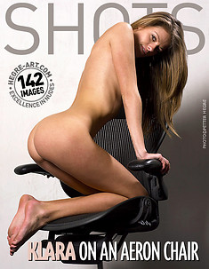 Klara nude on an aeron chair